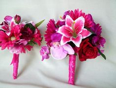 gorgeous bright pink varigated lillies, magneta orchids, red roses, gerbera daisies - for the bridesmaids maybe?