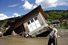 """reuterspictures: """"Gallery: Flood of a century A man reacts near a house tilted by floods in the village of Krupanj, west from Belgrade, Serbia May REUTERS/Marko Djurica """" Home Of The Brave, Land Of The Free, Extreme Weather, Earth Science, Ny Times, Croatia, Nasa, Solar, House Styles"""