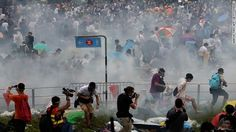 Hong Kong is being gripped by pro-democracy protests as student-led groups take to the streets. The protesters are responding to China's decision to allow only Beijing-vetted candidates to stand in the city's elections for chief executive. Above, tear gas is fired at protesters on Sunday, September 28, 2014 |via`tko CNN