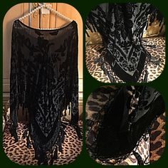 """Black chiffon, floral black velvet beaded poncho Stunning black chiffon, velvet and black beaded poncho.  What a stunning piece that is versatile in use as semi-formal or casual wear.  The base of the poncho is chiffon fabric covered in black velvet floral designs and black beads.  It had a round neckline trimmed at the bottom with approximately 60 hanging beaded tassels.  Measures 31"""" long and 57"""" wide.  One size fits most.  Professionally pressed and ready to wear.  Fabulous fashion accent…"""