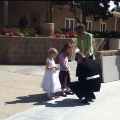 these little girls asked the Marine for his autograph.