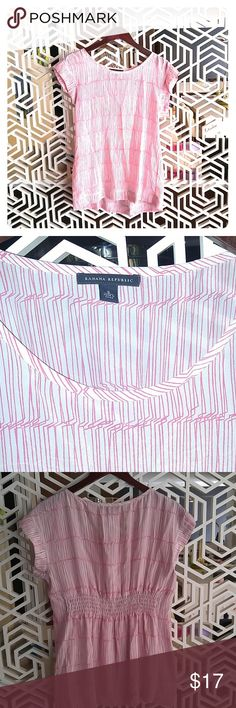 Banana republic silk tunic top small It's a gray and pink colored 100% silk top. Hits at thigh crease. Back cinch flatters waist line. See third photo. Banana Republic Tops Blouses