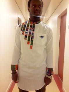 Tunique homme longue avec touche de wax par Marellefashiondesign pour Afrikrea. https://www.afrikrea.com/article/tunique-homme-chemises-blanc-pour-lui-coton-wax/RXW2TLF?utm_content=buffer56483&utm_medium=social&utm_source=pinterest.com&utm_campaign=buffer