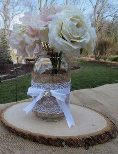Decorated Mason Jar and Wood Slice Wedding Centerpieces Decor Shabby Chic Rustic Bridal Shower. $24.50, via Etsy.