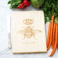 Hey, I found this really awesome Etsy listing at https://www.etsy.com/listing/154664296/french-queen-bee-cutting-board-solid