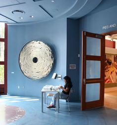 Donor wheel sculpture that is a motorized disk with 2000 names. By Joshua Kirsch