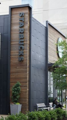 elZinc Graphite is a custom color of architectural zinc pre-weathered to a very dark, almost black, shade of grey. The beautiful dark hue of elZinc Graphite Building Exterior, Building Facade, Building Design, Building Elevation, Restaurant Exterior Design, Exterior Signage, Signage Design, Facade Design, Retail Architecture