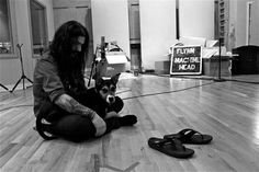 Robb Flynn (Machine Head) in the studio, holding a puppy.  I'm a lost cause right now...