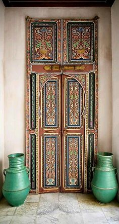 Detailed door with accent vases in Tanger, Morocco.