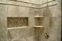 ceramic tile tub surround ideas | Stone corner shelves where installed in the front to keep toiletries ...