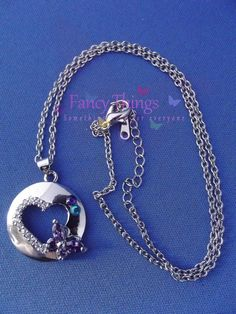 Silver Colored Necklace and Pendant.
