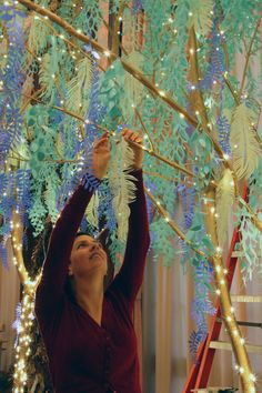 Malinda Swain and the team at Longwood Gardens attached the cut paper to the branches using hot glue and wire to create movement and a floating effect.
