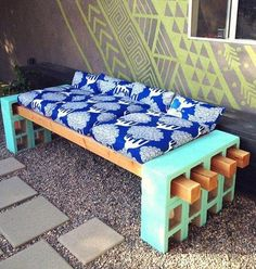 Katie Loves …a practical outdoor bench that requires ZERO power tools! Patterned cushions brighten up this simple cement blocks and stained wood creation. Photo: Lena Sekine