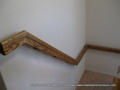 A wooden hand rail installed to assist access to the second story of a Simi Valley customer's home.