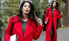 Pregnant Amal Clooney reveals just a hint of her baby bump
