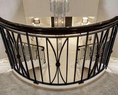www.trabczynski.com ST495 Dwustronne policzkowe schody gięte wykonane z dębu barwionego oraz dębu malowanego farbami kryjącymi. Balustrada z metaloplastyki. Realizacja wykonana w prywatnej rezydencji / ST495 Double, curved stair, full stringers manufactured in oak, solid white paint finish. Bespoke wrought iron balustrade.Profiled handrail made in stained oak finished to high gloss. Private residence.