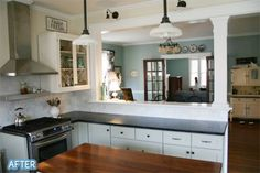 Featured on Better After :) Kitchen Aid dual fuel range; light fixtures above opening: www.rejuvenation.com