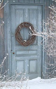 Grapevine wreath on slate blue door