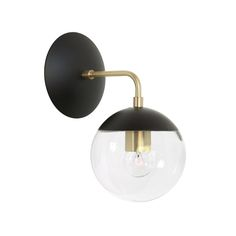 "Cedar & Moss Alto Sconce 6"". Shown in matte black and brass finish with clear glass."
