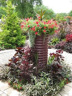love the idea of using corrugated metal culverts for planters.