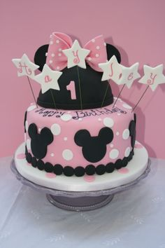 Minnie Mouse - Minnie Mouse themed cake for a one year old. Fondant bow and fondant mouse ears and cutouts on cake. The hat was a cake covered in fondant then I added the fondant ears on top.