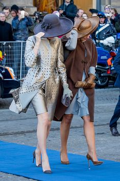 (R-L) Queen Maxima of the Netherlands welcome Queen Mathilde of Belgium during an official welcome ceremony at the Dam Square in the front of the Royal Palace at the start of the three-day state visit on 28 November 2016 in Amsterdam, The Netherlands.