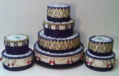 Check out this item in my Etsy shop https://www.etsy.com/listing/470854906/set-of-three-nautical-diaper-cakes-navy