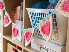 Granny triangle bunting #crochet hearts http://carinascraftblog.wardi.dk/2011/02/cute-heart-bunting.html And here is the link to the tutorial for crocheting the triangles: http://carinascraftblog.wardi.dk/2010/07/tutorial-crochet-granny-triangle.html Plus the tutorial for adding the hearts: http://michelleclement.typepad.com/blog/2011/02/hearts-on-a-string.html