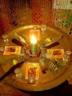 Bringing other elements into your candle magick.  Here feathers and tarot cards are being used.