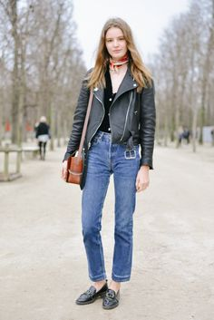 Tilda Lindstam in high waist jeans with leather motorcycle jacket. #streetstyle #vintagestyle