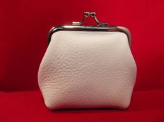 Small White Leather Change Purse, $24. I need a white one for my summer purse. . .