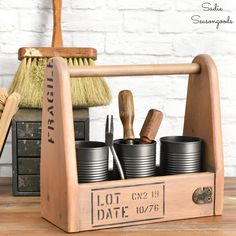 Industrial Style Decor with a Wooden Tool Caddy and Tin Cans