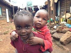 """'""""He ain't heavy. He's my brother."""" A sister transports her baby brother in Kibera, Kenya's largest slum.' -Nick Kristof"""