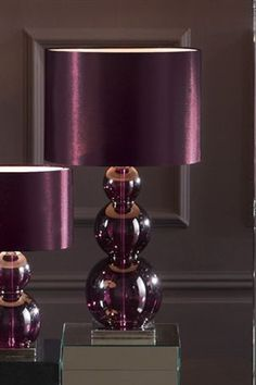 > > > Raindrops and Roses - Really like these eggplant colored lamps! These would look great w/ some amethyst curtains!