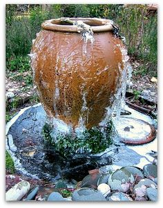 Diy garden fountain ideas how to create a water fountain includes excellent instructions and a video Diy Water Fountain, Diy Garden Fountains, Pond Fountains, Fountain Ideas, Fountain Design, Fountain Garden, Garden Hose, Fountain Lights, Outdoor Water Features