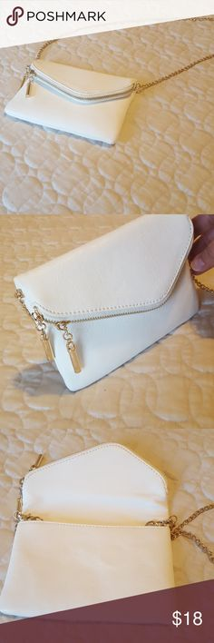 Vegan leather envelope clutch, NWOT Envelope style clutch cream colored vegan leather with gold zipper, magnetic fold, three credit card slits inside, detachable gold chain. No scuffs or scratches or stains, new withoiy tags Bags Crossbody Bags