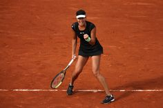Ana Ivanovic Photos Photos - Ana Ivanovic of Serbia  celebrates a point during her Women's Singles match against Yaroslava Shvedova of Kazakhstan on day one of the 2015 French Open at Roland Garros on May 24, 2015 in Paris, France. - 2015 French Open - Day One