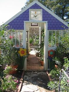 What I love about this is the front and back door.  So many times I want to go to opposite ends of the greenhouse. Combine a greenhouse, potting shed and patio area.