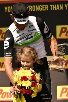 #TDF2016 Stage winner Great Britain's Mark Cavendish celebrates with his daughter on the podium at the end of the 188 km first stage of the 103rd edition of...