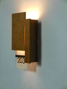 LUHRS City Center Marriott - Corridor wallsconces with LED backlit room numbers. Led Fixtures, Hospitality Design, House Numbers, Corridor, Light Decorations, Interior Design Living Room, Birch, Signage, Wall Lights
