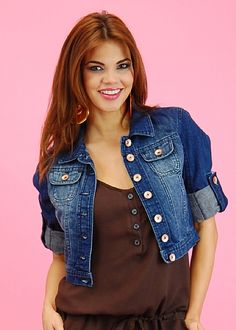 "This cropped denim jacket is to die for! Featuring a washed denim, button up closure, 2 small bust pockets and side pockets as well. Sleeves are cuffed but can be let loose if you want it longer. Pair it up with practically any outfit to give it that oomph it needs. Made from 71% cotton, 21% polyester and 8% viscose. Length from underarm down approx. 7"". Additional clothing and accessories shown are not included.  Price: $26.99"