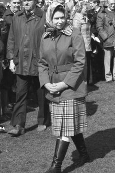 1978  She is famous for her iconic outdoorsy look - which Dolce & Gabbana paid tribute to for autumn/winter 2008-9, headscarf and all. Here, she is pictured in a Burberry check skirt and a belted jacket with a matching checked collar for a visit to Badminton. Photo By Rex Features
