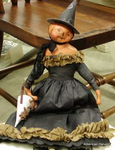 Lovely pumpkin doll.  Artist?