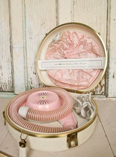 Vintage GE Deluxe Portable Bonnet Hair Dryer, Pink and Gold. $44.00, via Etsy.