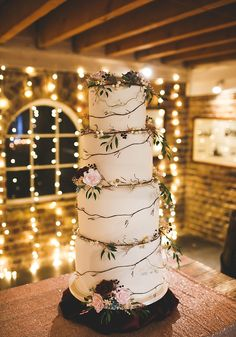 We LOVE this simply stunning wedding cake, decorated with garlands of greenery, berries and roses! A Beach Winter Wedding In Romantic Burgundy • Wedding Ideas magazine