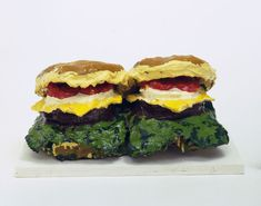 "Two Cheeseburgers, with Everything (Dual Hamburgers)  Claes Oldenburg (American, born Sweden 1929)    1962. Burlap soaked in plaster, painted with enamel, 7 x 14 3/4 x 8 5/8"" (17.8 x 37.5 x 21.8 cm). Philip Johnson Fund. © 2012 Claes Oldenburg"
