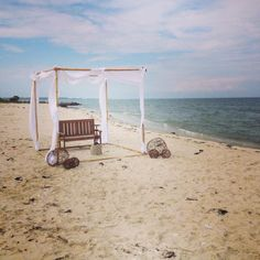Beach wedding alter my father made using bamboo.  Grapevine balls were made from grapevine sheets found at Michaels.