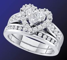 There's nothing more romantic than this heart-themed bridal set from GND's Enchanting Bliss Bridal Collection. The 14-karat gold set has a diamond total weight of 1 carat and spotlights a heart-shaped center formed by two round diamonds and one princess-cut diamond. Get all the details and see the complete line here... http://www.jewelrysupercenter.com/index.php?file=productlist&icatid=778&ichangeid=1 #enchantingblissbygnd #engagement