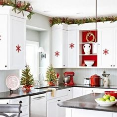 Lovely Modern White Kitchen With Small Red Snowflake Stickers As Well As Chic Green Garland On White Cabinets