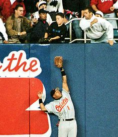 Oct 9, 1996 - Bernie Williams hits a home run in the 11th inning to give the New York Yankees a 5 - 4 victory over Baltimore in Game 1 of the American League Championship Series. The Yankees receive a great help from a young fan when 12-year-old Jeffrey Maier creates a game-tying homer by Derek Jeter in the 8th inning, when he reaches out and grabs a ball that was about to be caught by right fielder Tony Tarasco.[photo] Bernie Williams, Bull Durham, American League, Derek Jeter, Game 1, 12 Year Old, New York Yankees, Baltimore, Victorious